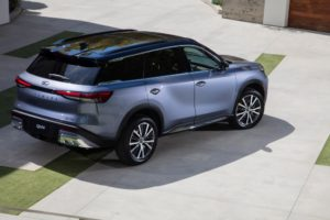 The all-new 2022 INFINITI QX60, combining powerful athleticism with harmony and simplicity. Available two-tone roof, a first for INFINITI. AUTOGRAPH grade shown in Moonbow Blue. Not yet available for purchase. Expected availability, late 2021. Pre-production model shown. Actual production model may vary.