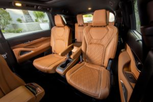 The all-new 2022 INFINITI QX60's spacious interior cabin is highly functional and intuitive, assembled with precision and wrapped in premium soft-touch materials with a craftsman's feel. Exclusive to the QX60 AUTOGRAPH grade, standard captain's chairs provide first-class seating accommodations in the second row. AUTOGRAPH grade shown. Not yet available for purchase. Expected availability, late 2021. Pre-production model shown. Actual production model may vary.